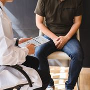 male doctor and testicular cancer patient are discussing about testicular cancer test report testicular cancer and prostate cancer concept