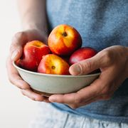 man holding fresh peaches summer healthy food concept
