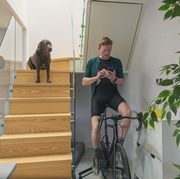 man on cycling trainer at home