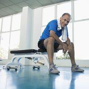 man sitting on exercise bench