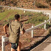 man running up hill