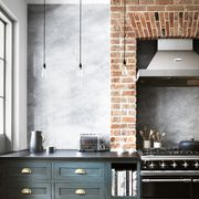 rustic kitchen withgreen cabinets and marble backsplash