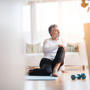 a mature man doing exercise at home