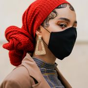 woman with red scarf and black face mask
