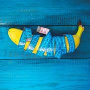 measure tape wrapped around banana