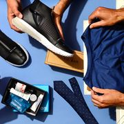 men holding sneakers, grooming products and shirt