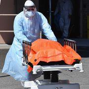 hospital employee pushing gurney