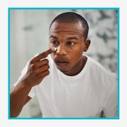 kiehl's acne spot treatment product and man applying acne spot treatment