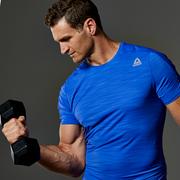 Arm, Elbow, T-shirt, Muscle, Logo, Wrist, Mobile phone, Portable communications device, Trunks, Bermuda shorts,
