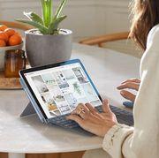woman using microsoft surface 2 mini laptop