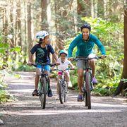 mom and kids race on bikes