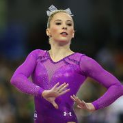 mykayla skinner in a magenta sparkly leotard with a white silver bow