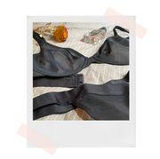 negative underwear sieve demi bra on model and bed