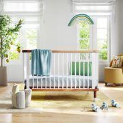nestig cloud crib in yellow and blue baby nursery