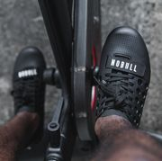 man wearing nobull cycling shoes on indoor bike