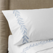 bedding with blue embroidery