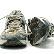 pair of old used running shoes isolated on white background
