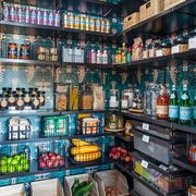organized pantry with blue wallpaper