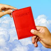 hands holding passport with cover