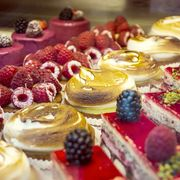 Pastries deserts at bakery window in Paris