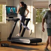 woman running on peloton treadmill