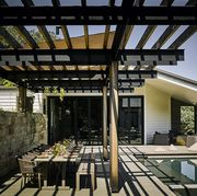 pergola in backyard with pool