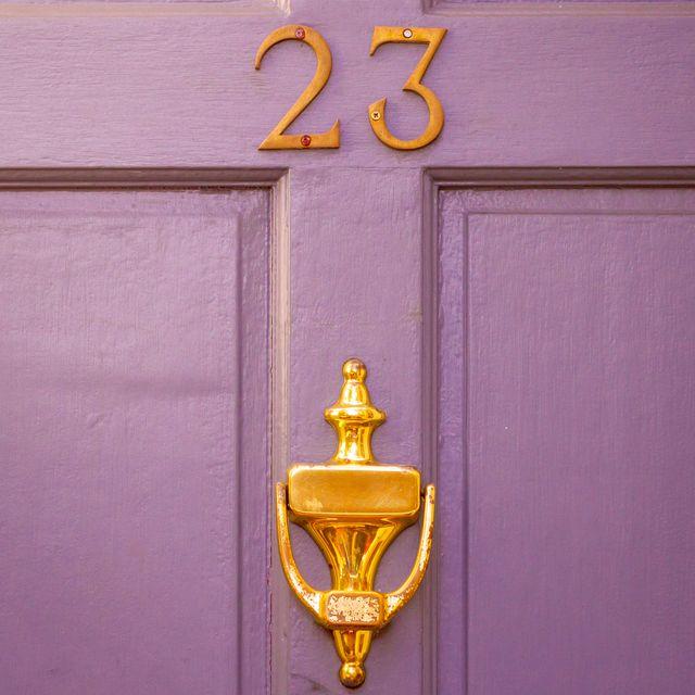 house number 23 on purple front door