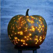 Pumpkin, Calabaza, Purple, Lighting, Vegetable, Jack-o'-lantern, Fruit, Plant, Still life photography, Carving,