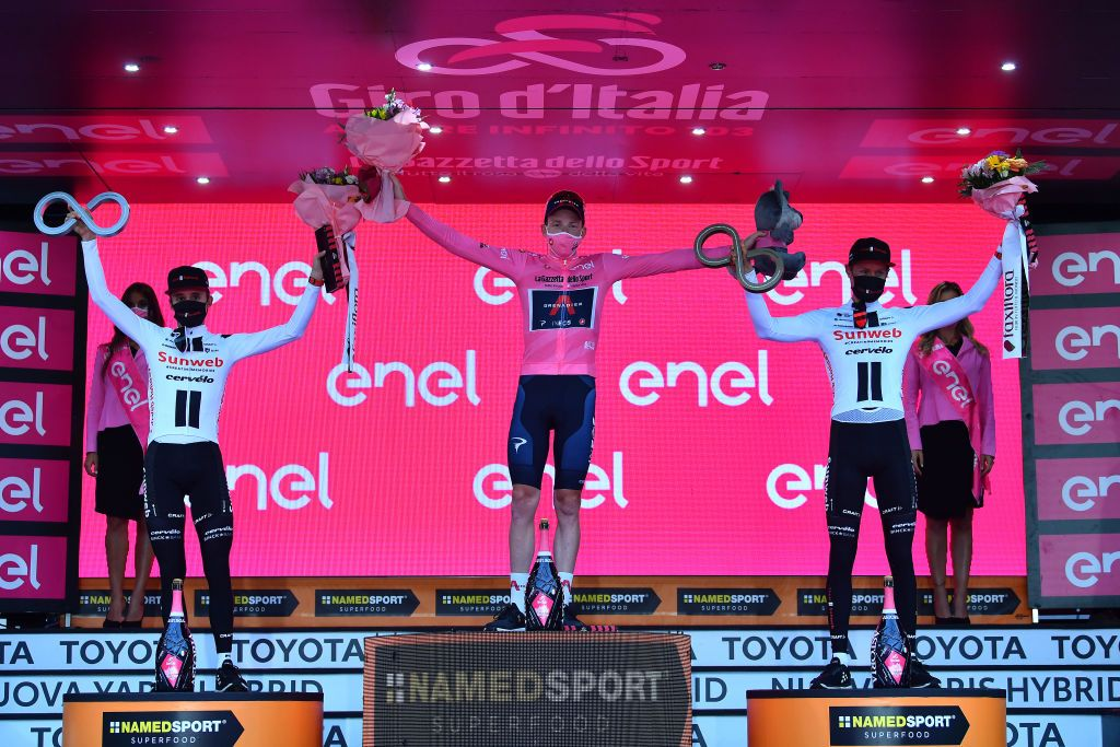 Jai Hindley of Team Sunweb, Tao Geoghegan Hart of Team INEOS Grenadiers, and Wilco Kelderman of Team Sunweb on the Giro d'Italia podium.