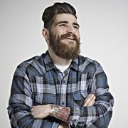portrait of male in check shirt laughing