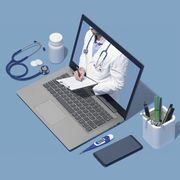 professional doctor giving a consultation online in a laptop