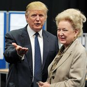 US property tycoon Donald Trump (L) is p