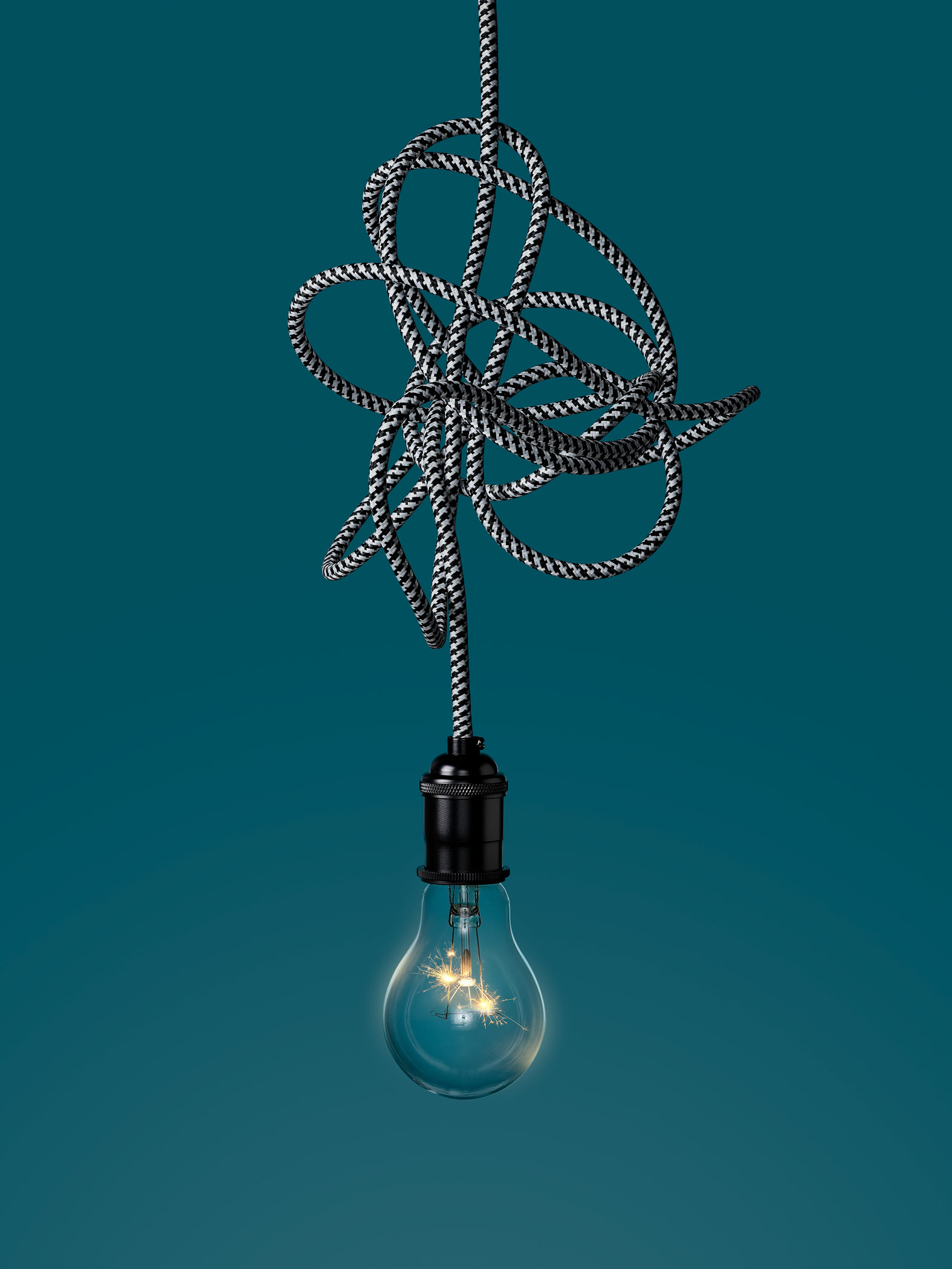 light bulb hanging from tangled wire