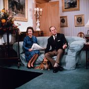 queen elizabeth and prince philip relaxing on couch