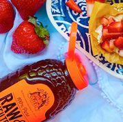 nature nate's raw honey with strawberry dessert