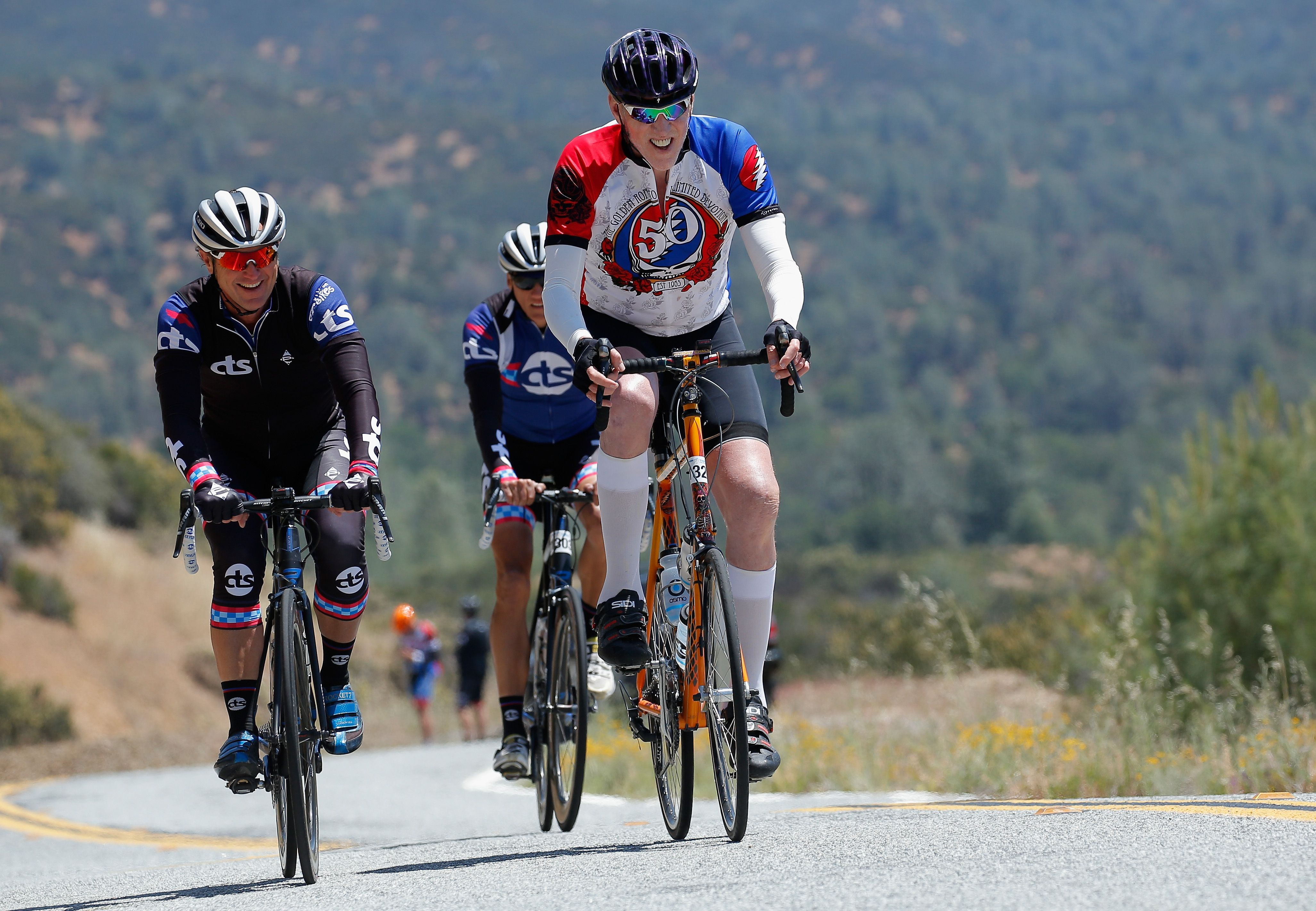NBA legend Bill Walton, right, rides with Chris Carmichael, left, ahead of stage two of the 2015 Amgen Tour of California.