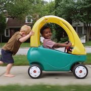 kids playing with cozy coupe ride on toy