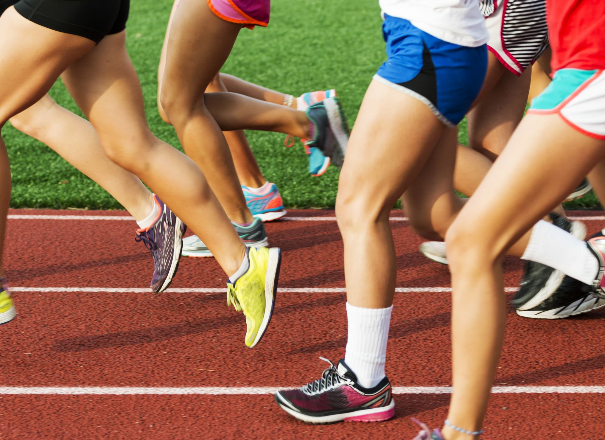 Runners legs on a red track
