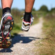 Feet Running on Trail