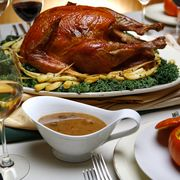 Salt–rubbed, roasted turkey with roasted parsnips, pan sauce, center and spiced pumpkin soup with m