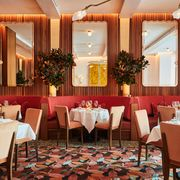 red banquettes and velvet chairs in sant ambroeus brookfield place