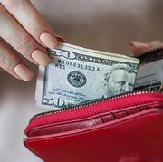 Cash, Money, Currency, Wallet, Coin purse, Zipper, Dollar, Money handling, Fashion accessory, Hand,