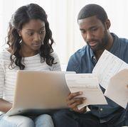 save money fast - couple paying bills