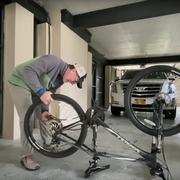 Stephen Colbert fixes a flat bike tire