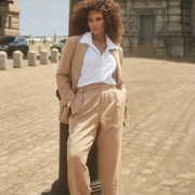 a model wears khaki suiting from 11 honoré in a news story about 11 honoré bringing plus size clothing to nordstrom