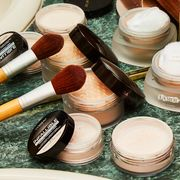 setting powders on bathroom counter with makeup brush