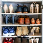 heels boots sneakers on shelves in shoe cabinet