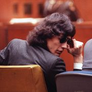 mandatory credit photo by nick utapshutterstock 6572289a ramirez richard ramirez adjusts his sunglasses in the courtroom during a special hearing in los angeles, ca,  ramirez, known as the night stalker, is on trial for thirteen counts of murder committed in 1985 at right is his attorney, daniel hernandez ramirez was born feb 28, 1960 ramirez night stalker trial, los angeles, usa