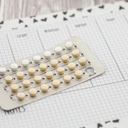 Contraceptive pills on a calendar.