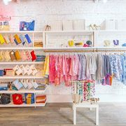 Room, Pink, Clothes hanger, Textile, Footwear, Shelf, Interior design, Furniture, Boutique, Outlet store,